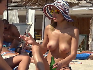 busty young girl with glasses on the beach