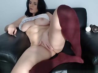 Busty brunette shows pussy