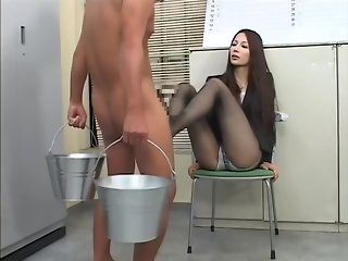 Sexy Japanese female boss in nylon stockings gives her employee a great footjob at the office