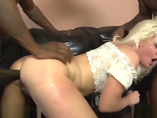 Tiny blonde takes two black cocks