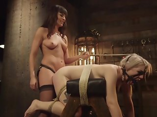 Blonde lesbian slave is spanked