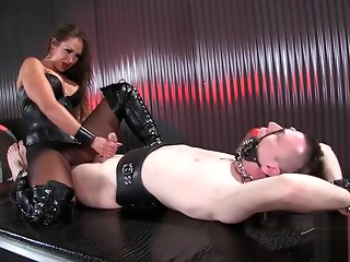 Sexy mistress Yasmin jerks the cum out of slaves cock