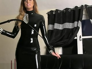 Natalia Forrest in black latex dress