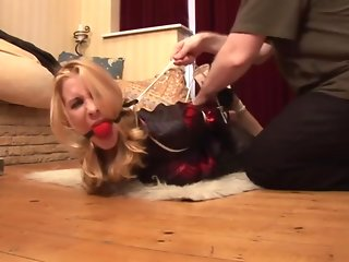 Girl with blouse hogtied and ballgagged